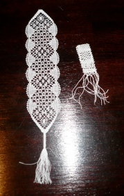 A lace bookmark by Barbara Philo next to my considerably more modest go at lacemaking.